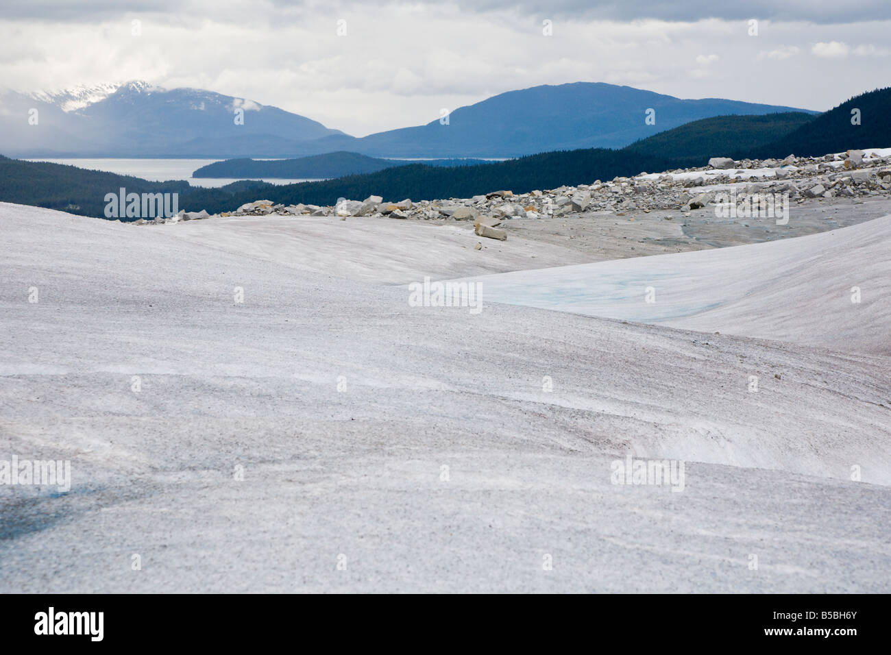 Waves of ice form the top of Mendenhall Glacier near Juneau, Alaska - Stock Image