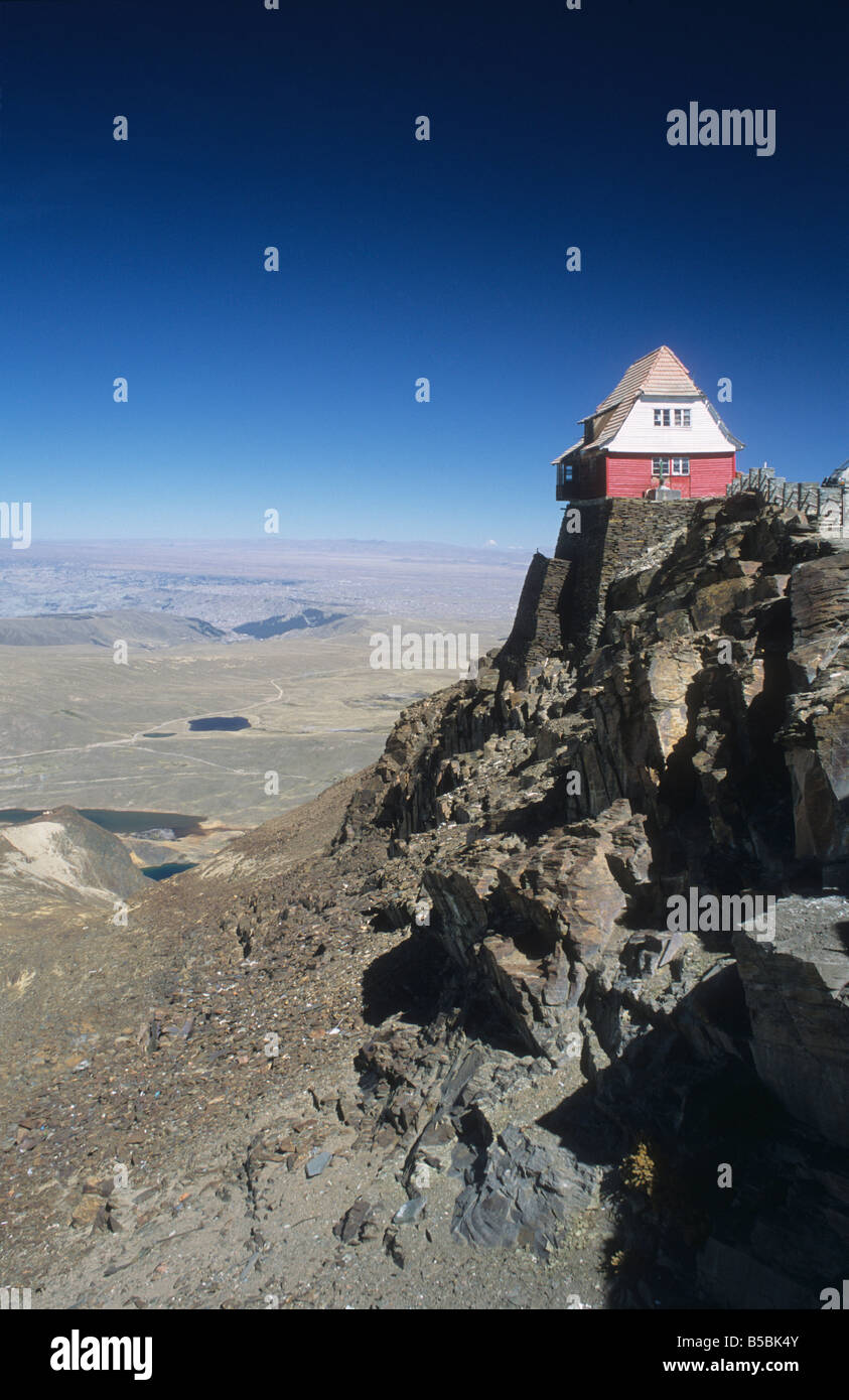 The old ski hut on Mt. Chacaltaya, altiplano in distance, Cordillera Real, Bolivia Stock Photo