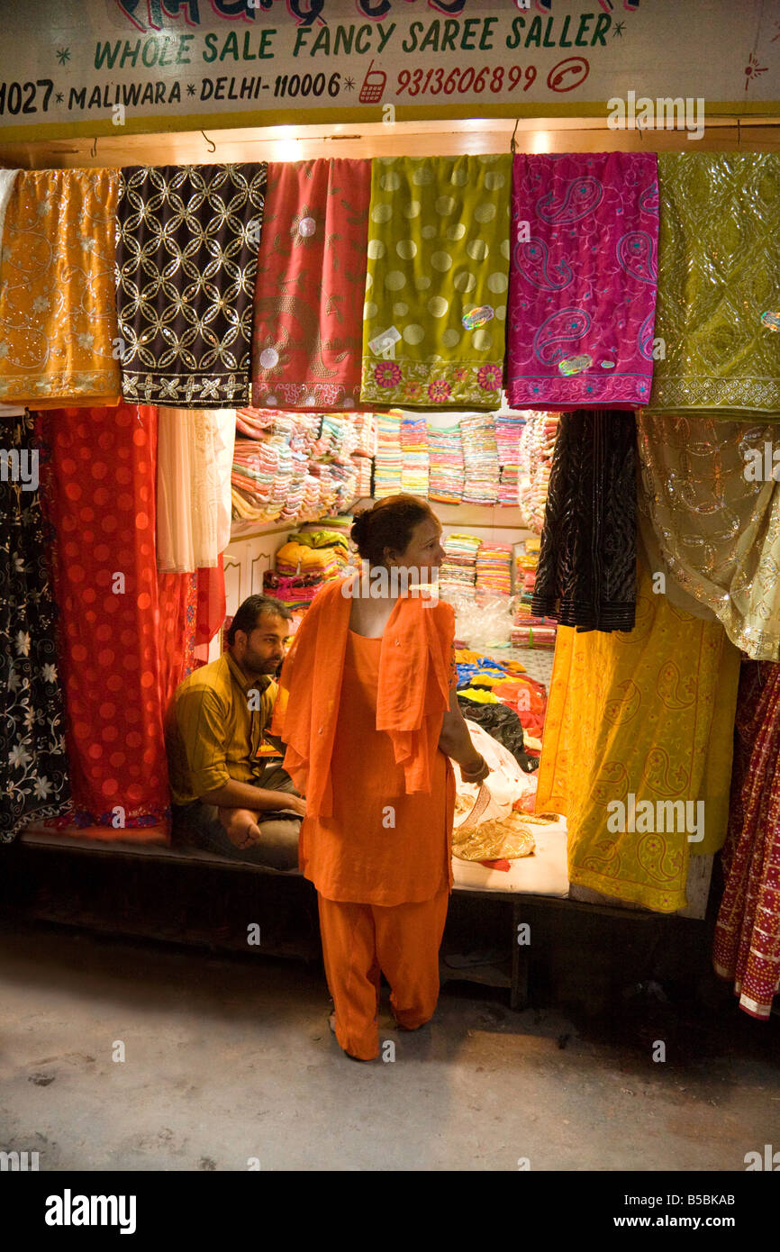 260b089987 A Woman buying saris in a shop in the Kinari market, 'Old Delhi'