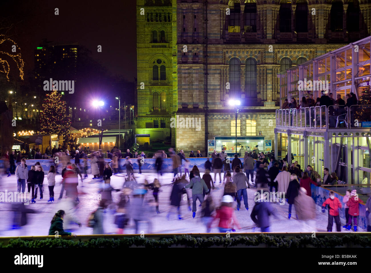 Ice skating outside the Natural History Museum, London, England, Europe - Stock Image