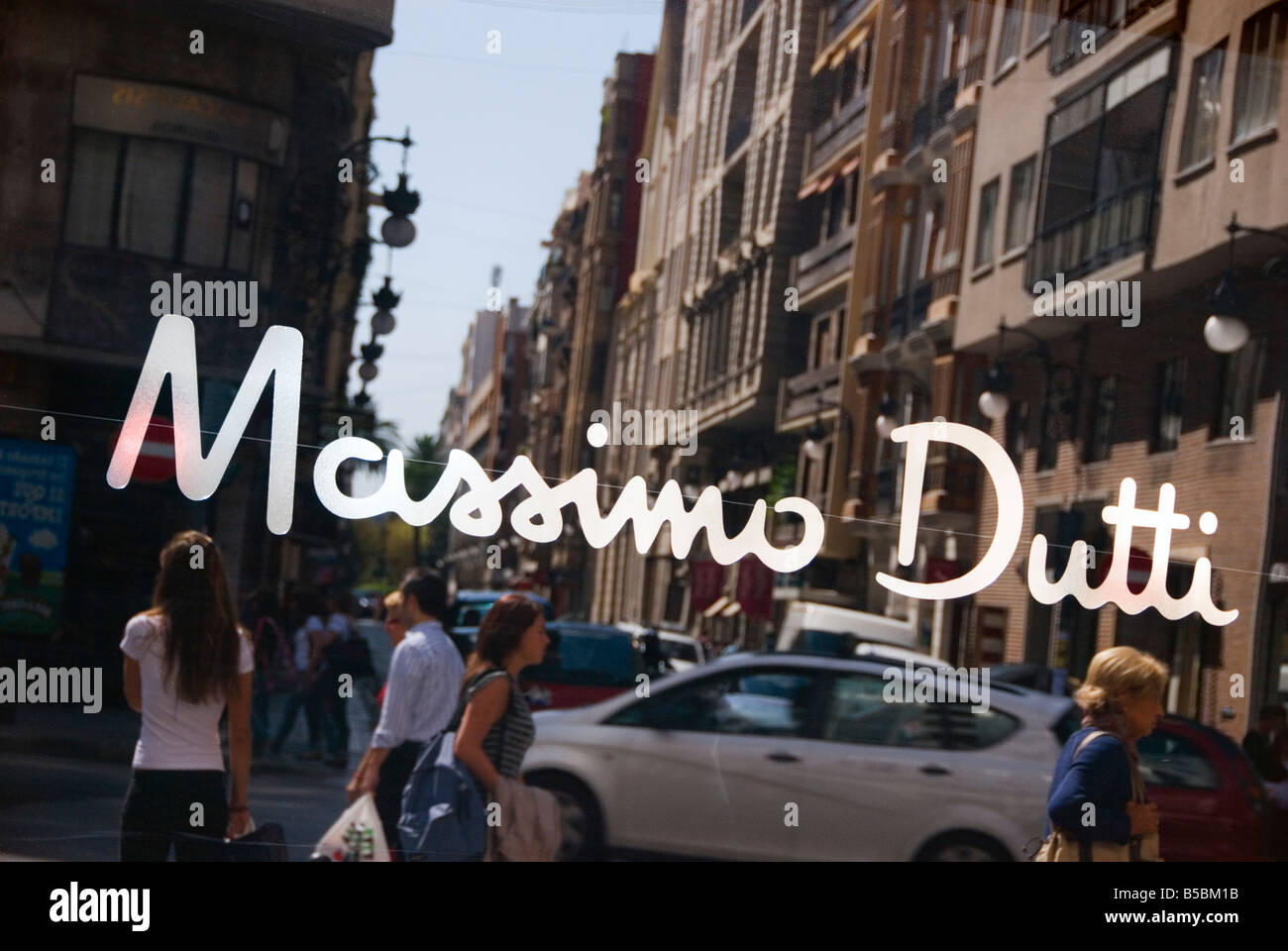 Shop window sign of Spanish high street fashion retail chain store Massimo Dutti owned by the INDITEX GROUP - Stock Image