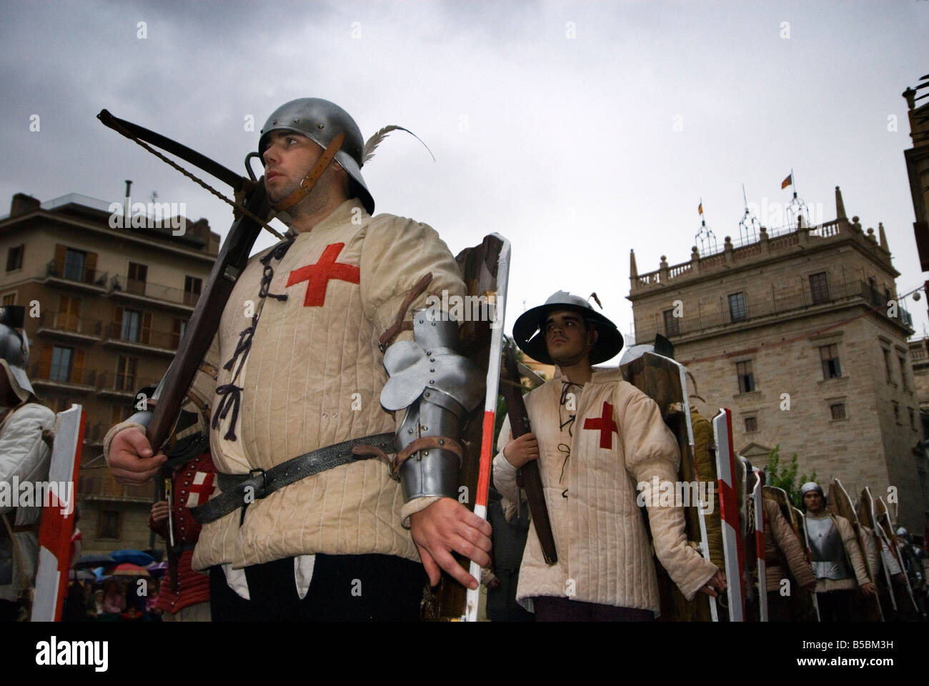 Christian soldiers with crossbow in Spanish civic parade Valencia celebrates its fiesta Nou D Octubre 9th October - Stock Image