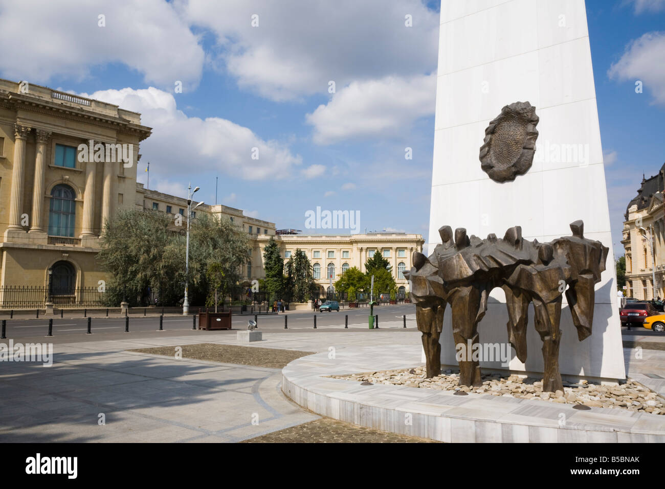 Bucharest Romania Revolution Monument and bronze statues memorial to the 1989 dead in Revolution Square in city - Stock Image