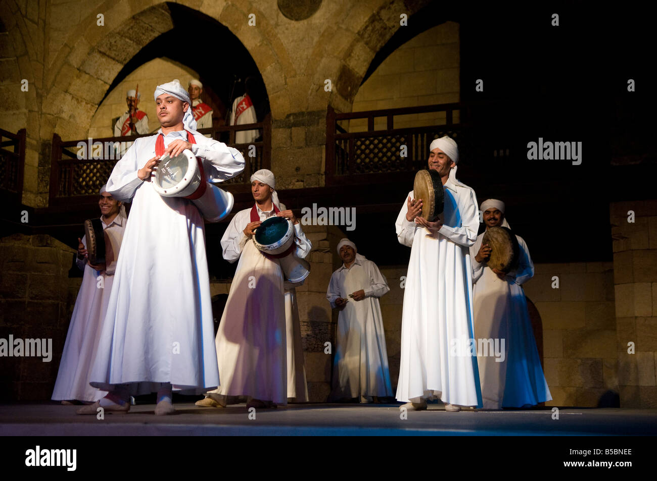 Dervish or Darvish performance of al tannoura Egyptian heritage dance troupe at the Wekalet el Ghouri Arts Center - Stock Image