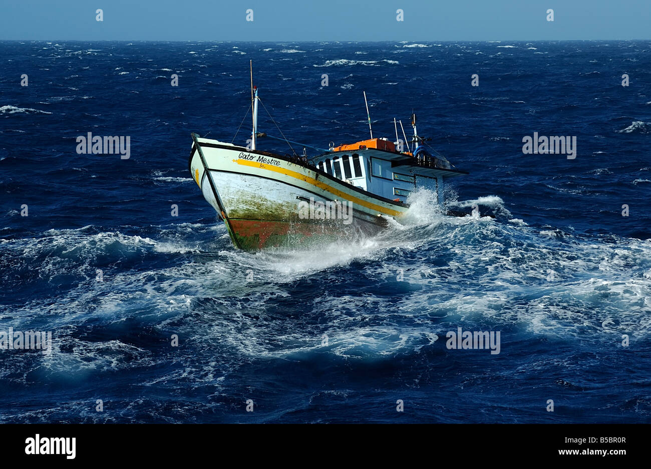 Fishing boat in rough sea stock photo 20543175 alamy for Ocean fishing boats