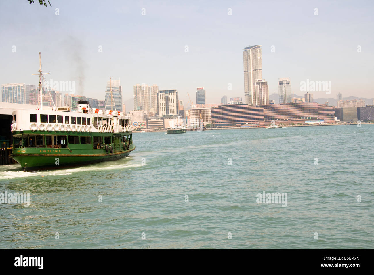 The star ferry leaves Hong Kong island and heads to Tsim Sha Tsui, Kowloon - Stock Image