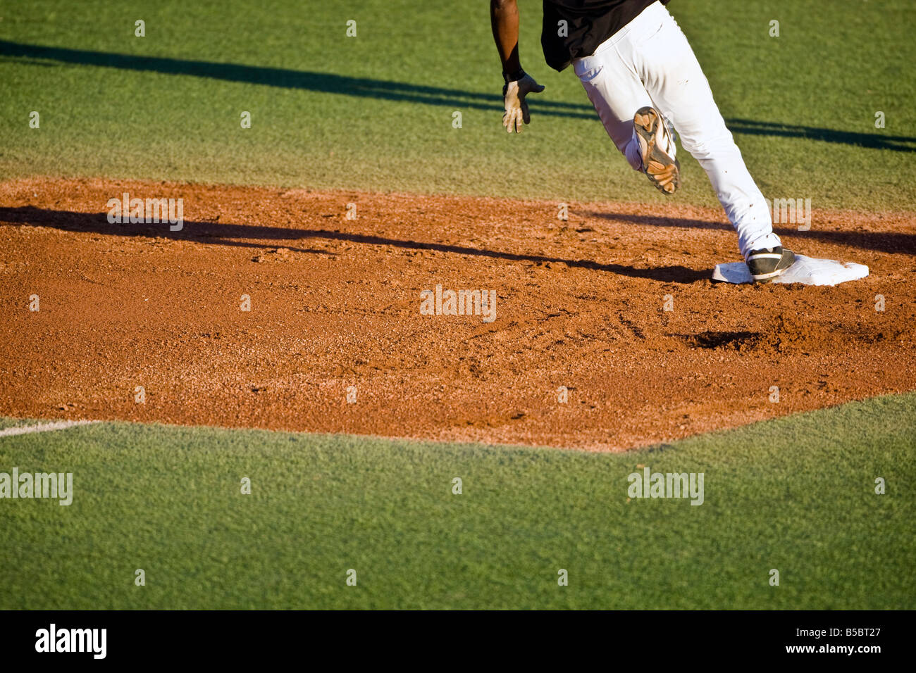 Baseball player running bases - Stock Image