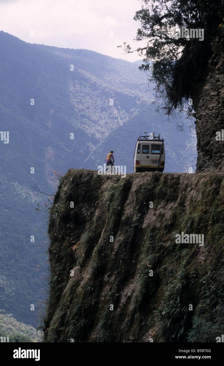 Mountain biker and minibus on The World's Most Dangerous Road /  La Carretera de la Muerte from La Paz to Coroico, Stock Photo