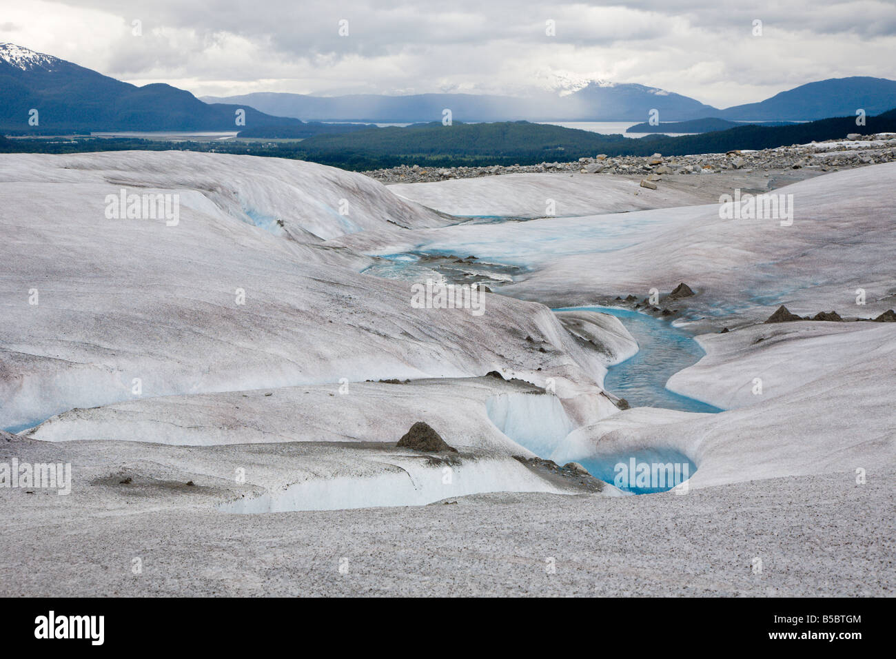 Meltng ice carves streams into top of Mendenhall Glacier near Juneau, Alaska - Stock Image