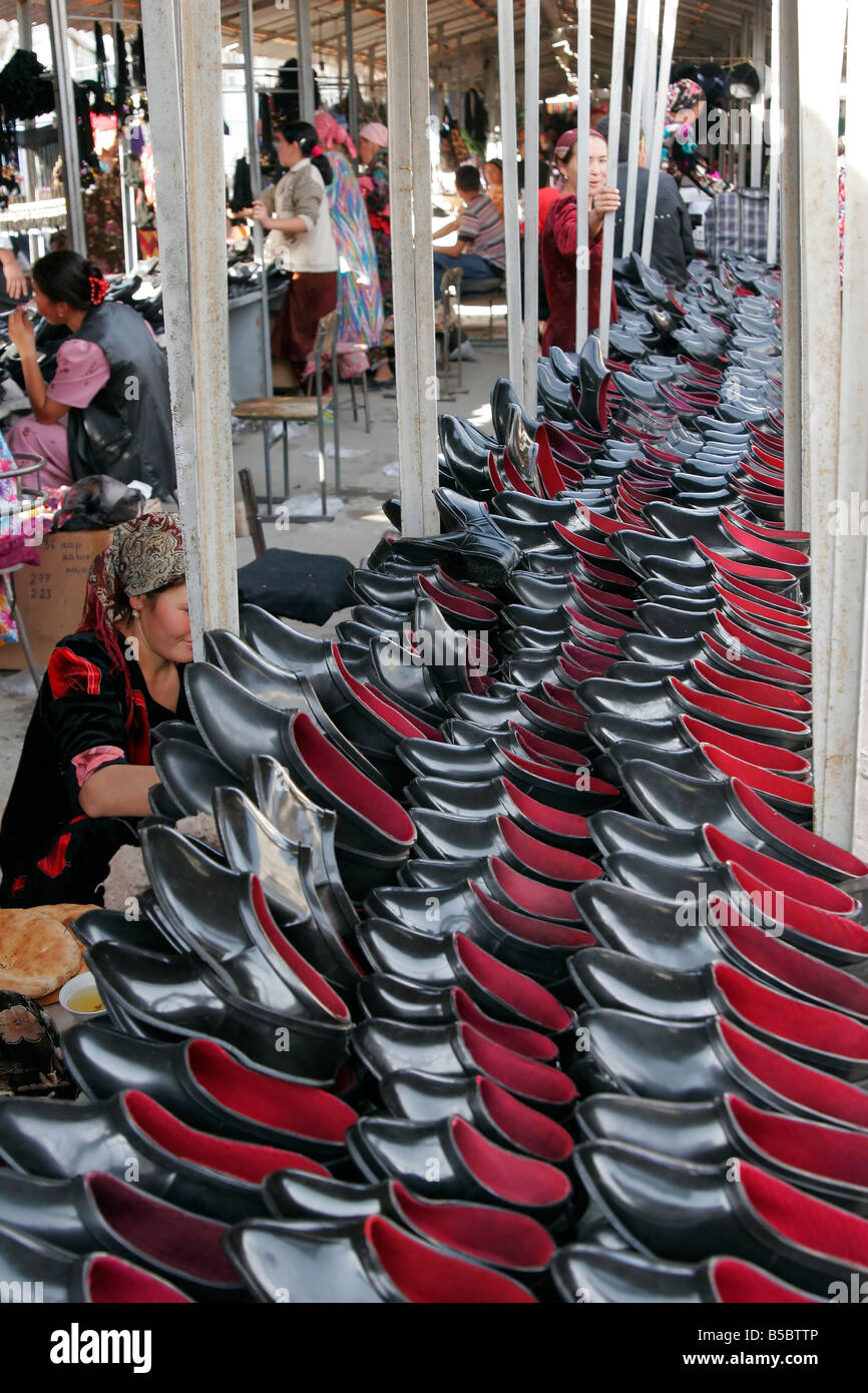 Black rubber boots for sale, Sunday market in Urgut, Uzbekistan, Central Asia Stock Photo