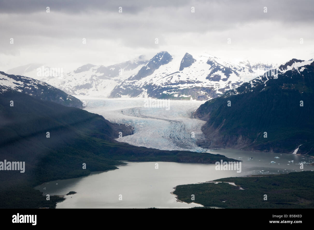 Mendenhall Glacier flows into Mendenhall Lake near Juneau, Alaska, USA - Stock Image