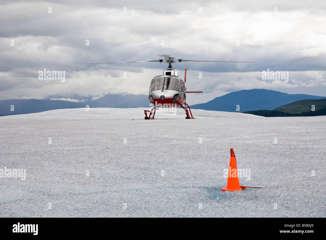 Helicopter landing on top of Mendenhall Glacier near Juneau Alaska - Stock Image