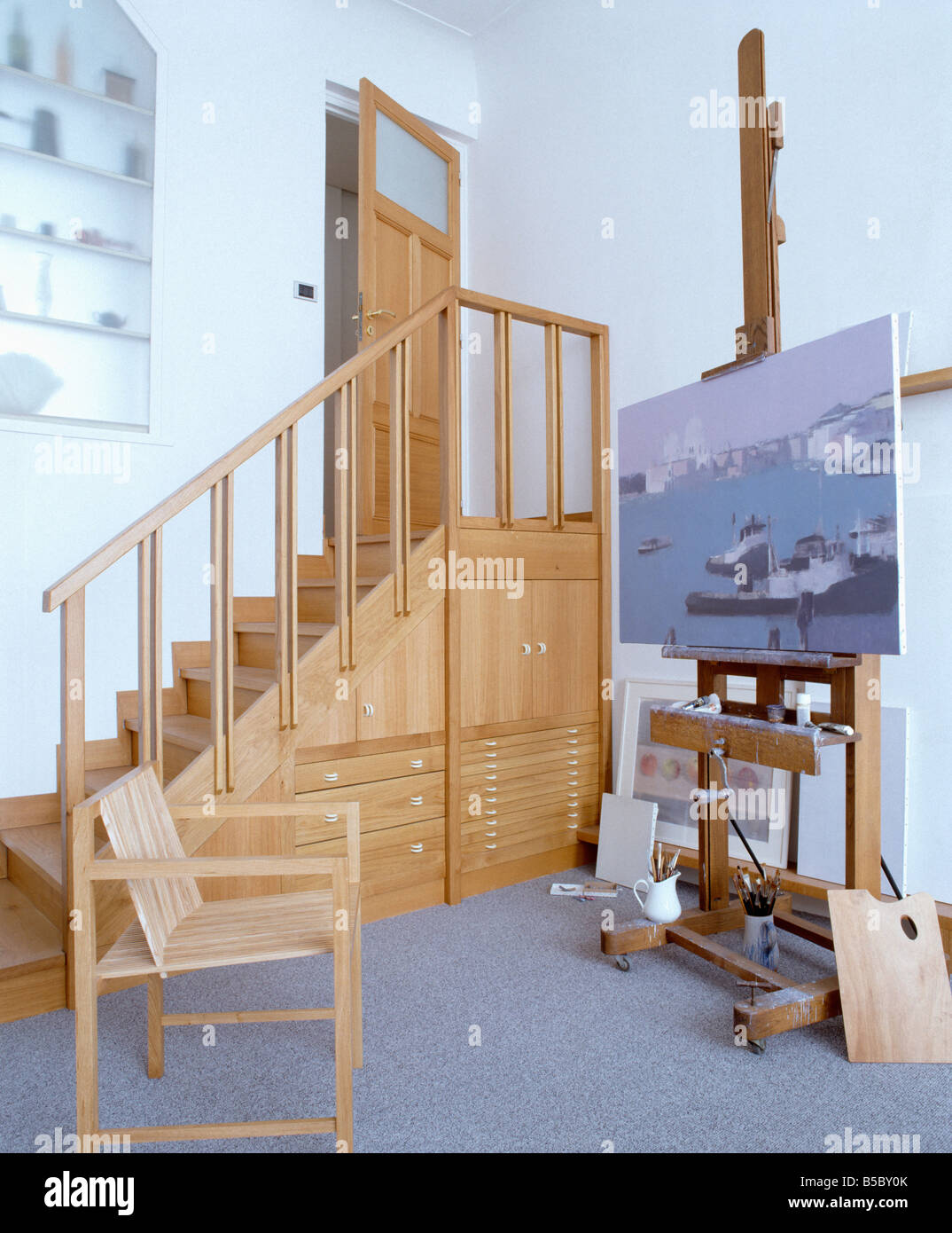 Seascape Painting On Wooden Easel In Artistu0027s Studio With Fitted Storage  Drawers In Wooden Staircase