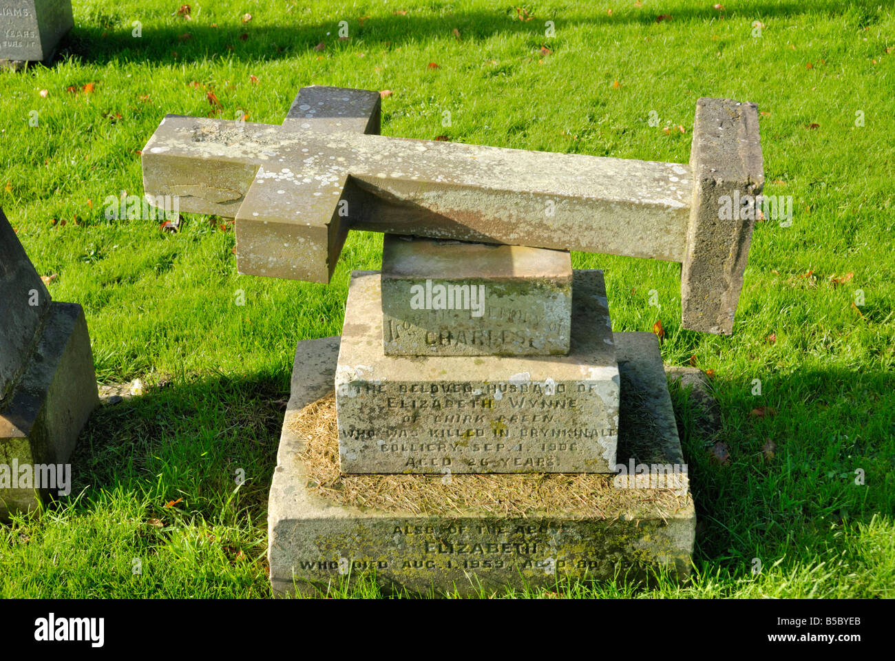 Unsafe gravestone laid flat at St Marys Church Chirk North Wales - Stock Image