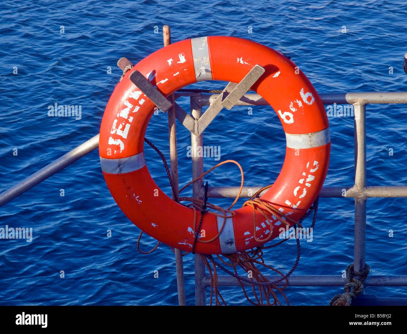 Life belt on railing - Stock Image