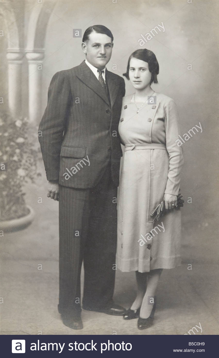 young adult couple posing in studio vintage photograph - Stock Image