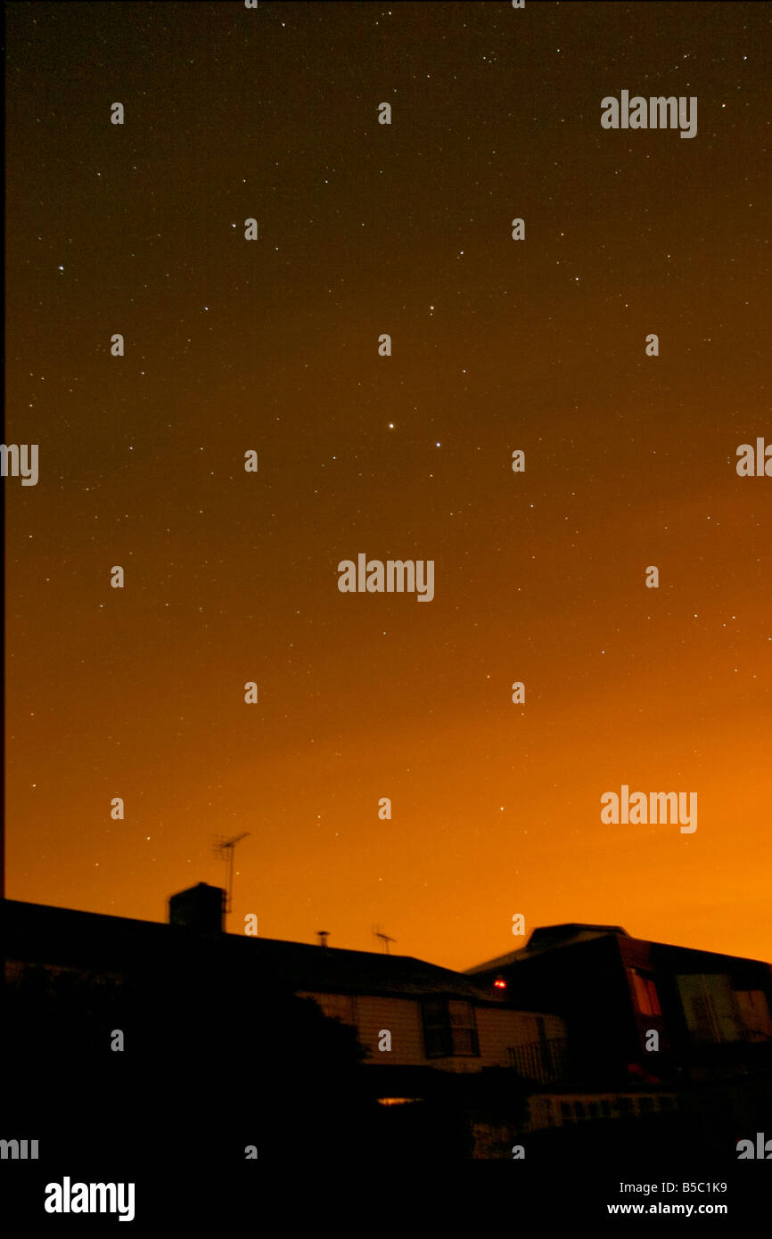 Planet Saturn in Leo over cottages Stock Photo: 20548397 - Alamy