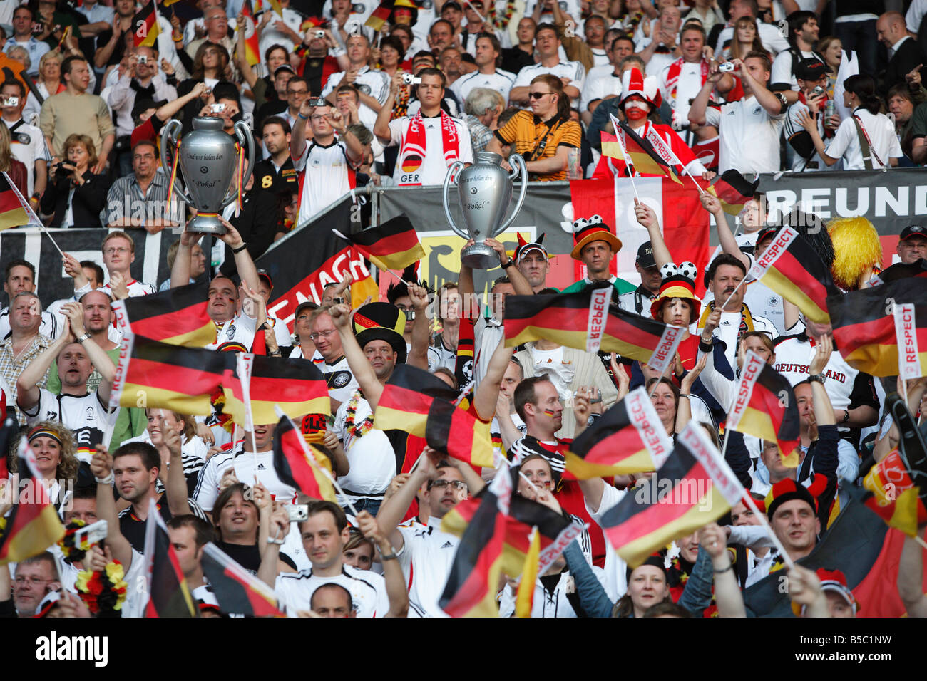 German supporters cheer their team prior to the start of a UEFA Euro 2008 group stage match against Austria. Stock Photo