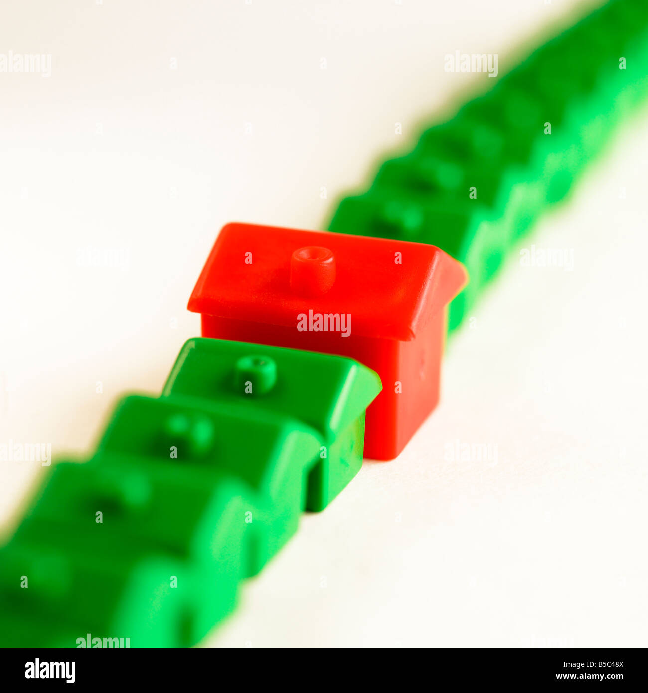 Monopoly house in a row - Stock Image