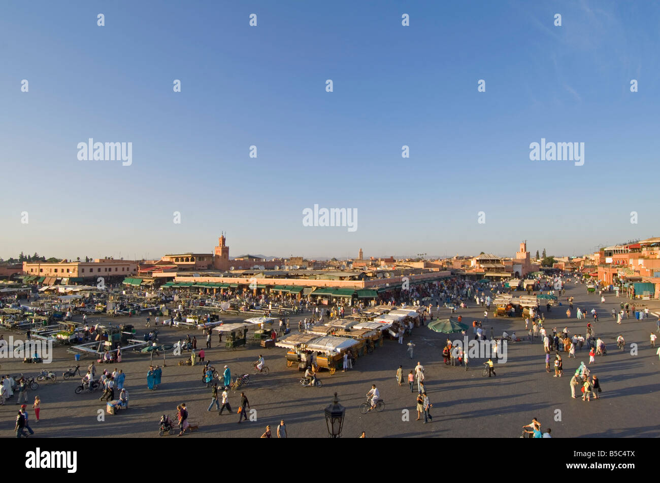 A wide aerial view of the Djemaa El Fna in Marrakesh as it starts to fill up in the late afternoon sun. - Stock Image