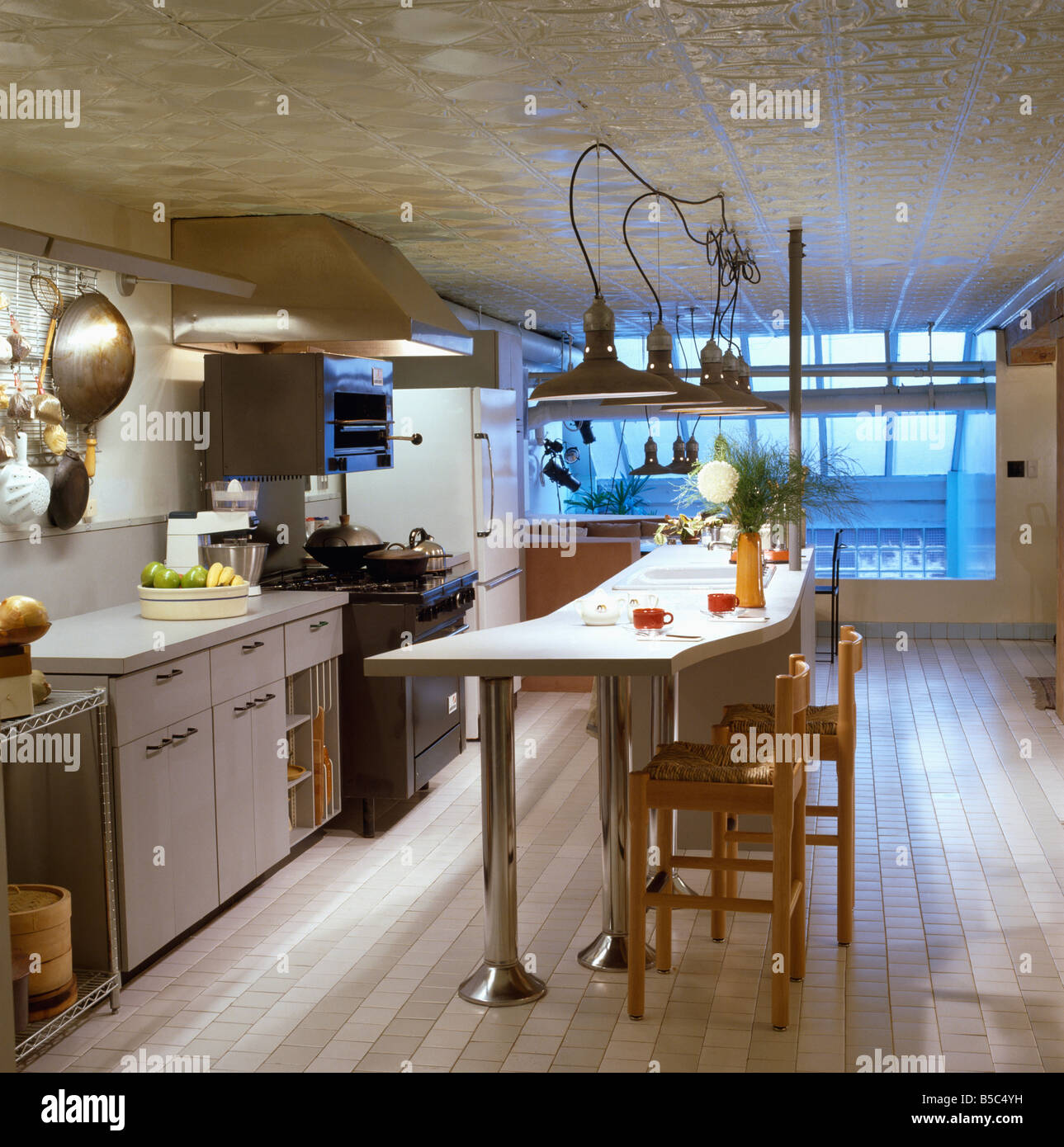 Pendant Lighting Kitchen Bar: Pendant Lights Above Breakfast Bar With Wooden Stools In