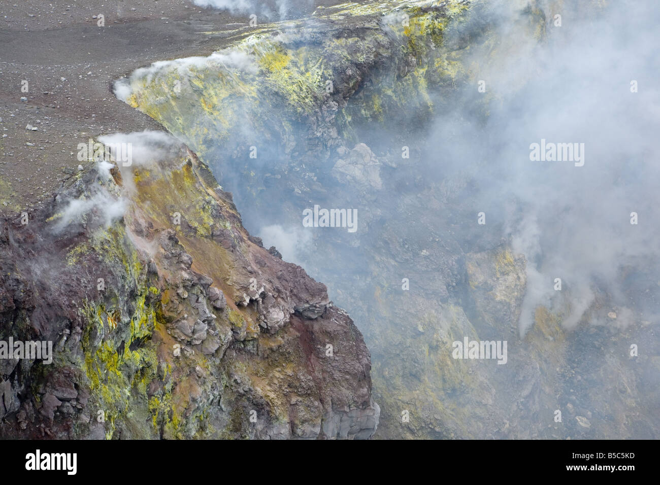 Mt Etna volcano's steep inner crater walls with fumaroles and sulphur deposits - Stock Image