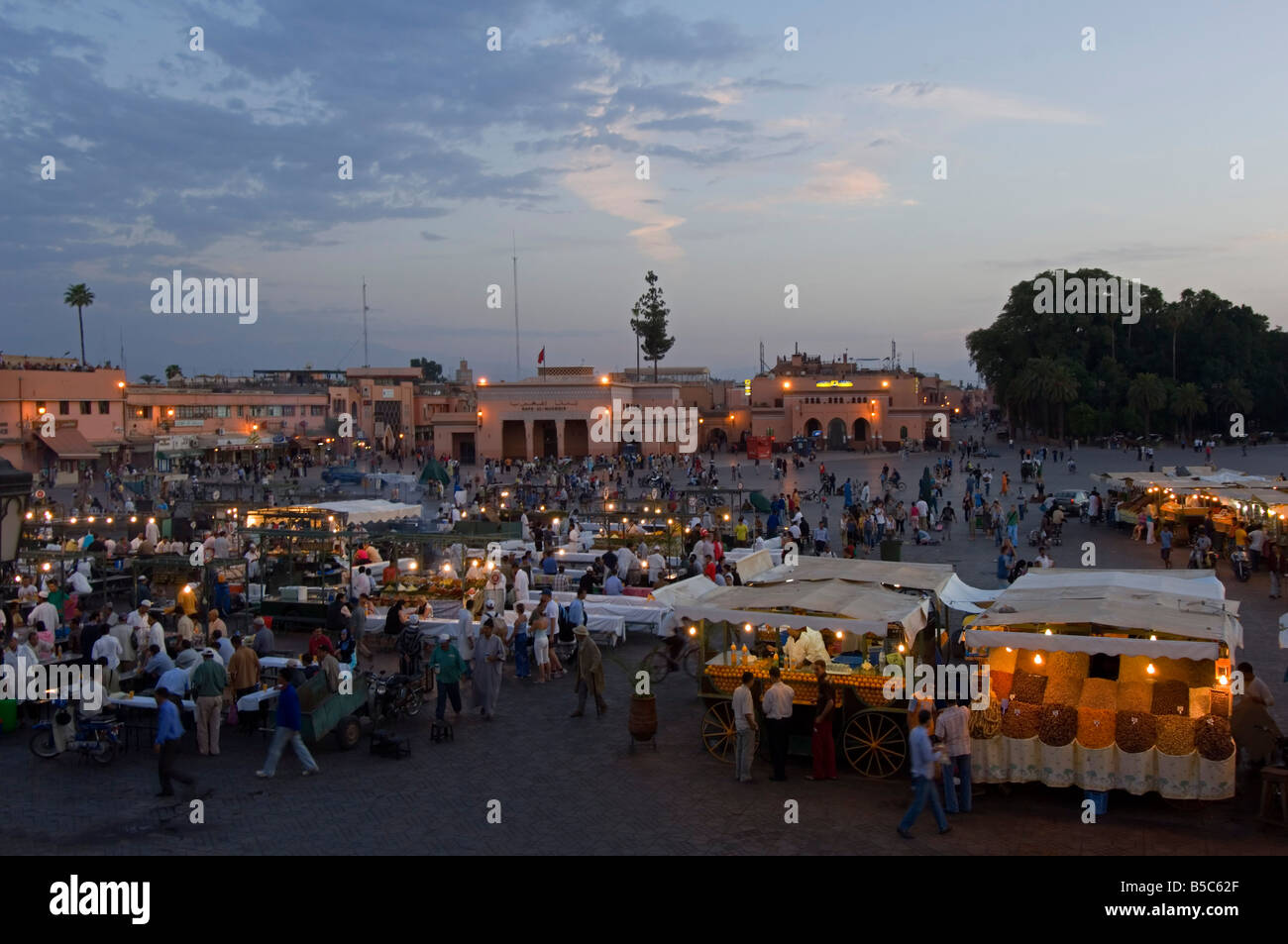 A wide aerial view of the Djemaa El Fna in Marrakesh and open air 'restaurants' as it starts to fill up - Stock Image