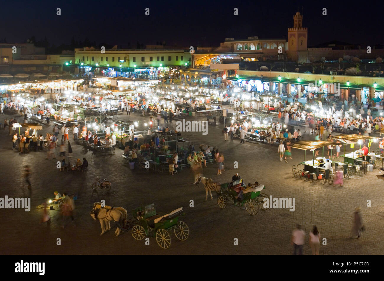 A wide angle aerial view of the busy Djemaa El Fna in Marrakesh at night with slow shutter speed for motion blur. - Stock Image