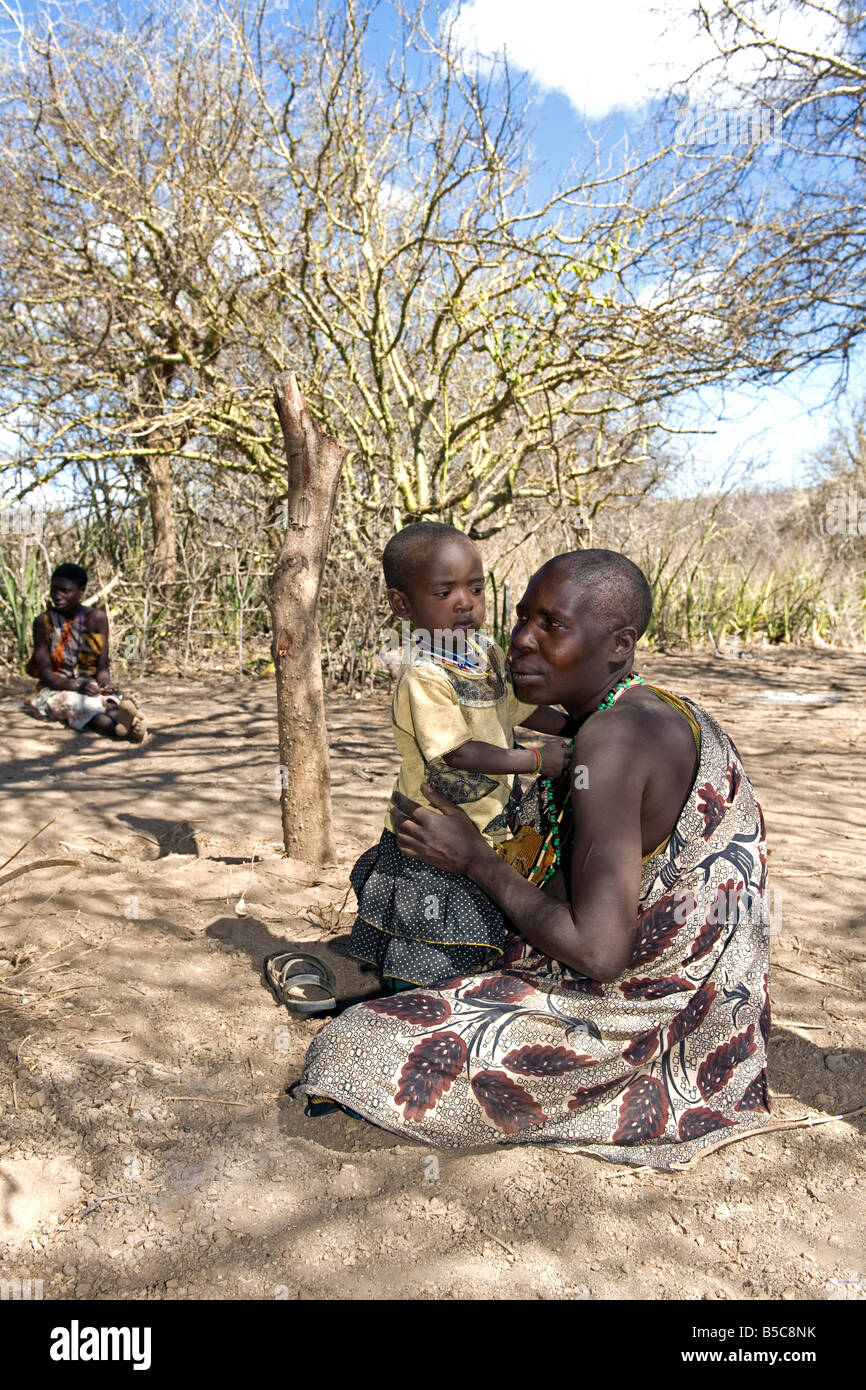 A woman of the the Hadza with her child Lake Eyasi Tanzania - Stock Image