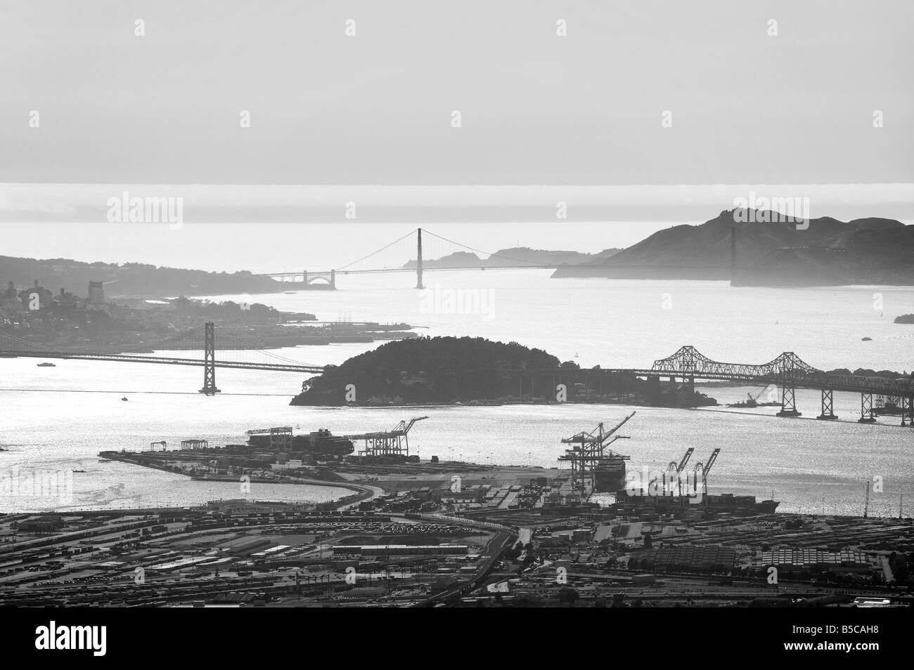 aerial view above the Port of Oakland to the Bay Bridge Treasure Island and Golden Gate bridge San Francisco bay - Stock Image