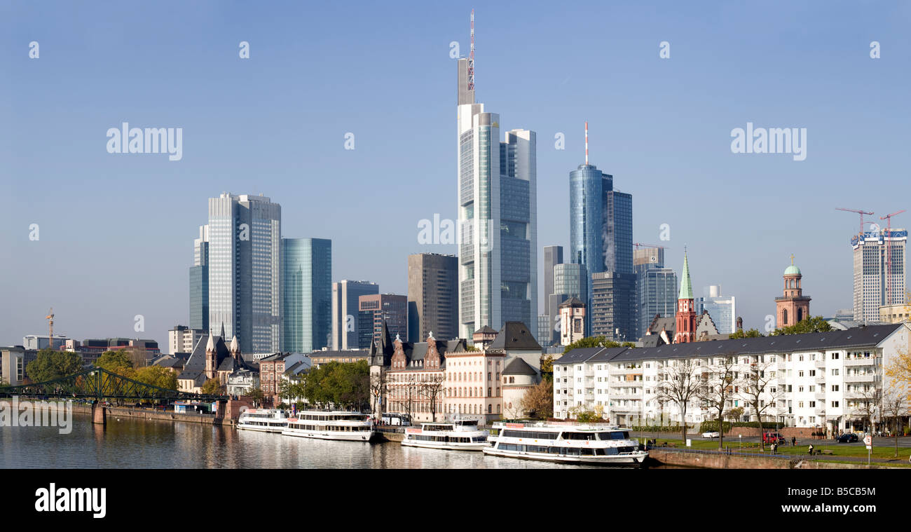 skyscrapers at Frankfurt financial district, River Main with tourist boats - Stock Image