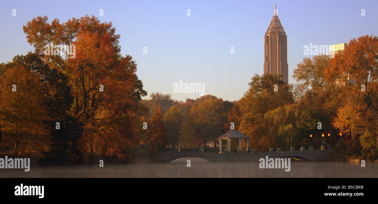 A morning shot of the bridge crossing the lake in Piedmont Park during the fall season - Stock Image