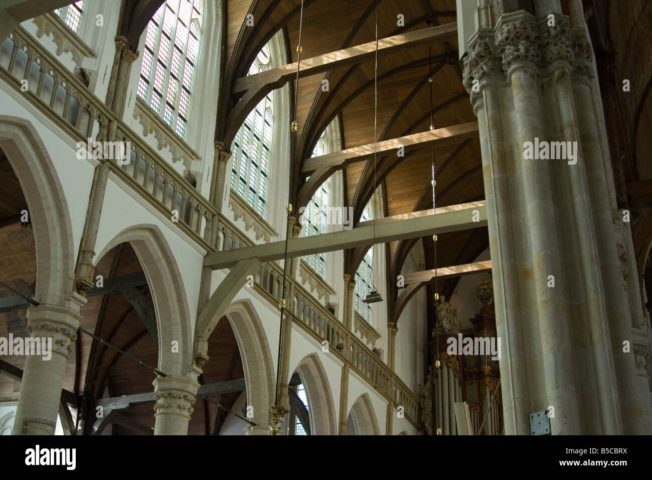 Church beams column columns windows arch archway wood stone plaster wooden repetition god religion cathedral - Stock Image