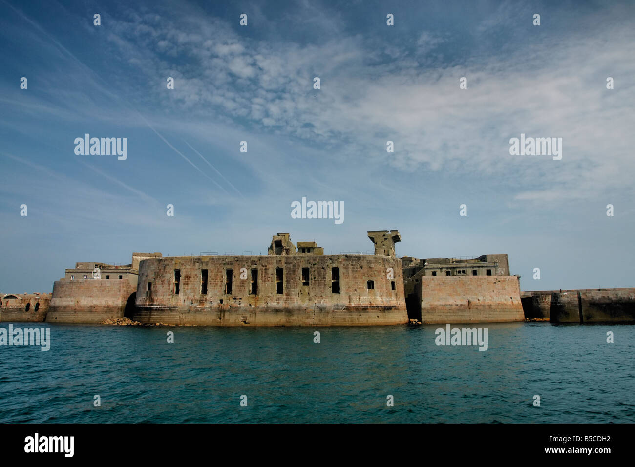 An ancient breakwater and fort, including German add-ons from WWII, in the Cherbourg port, france - Stock Image