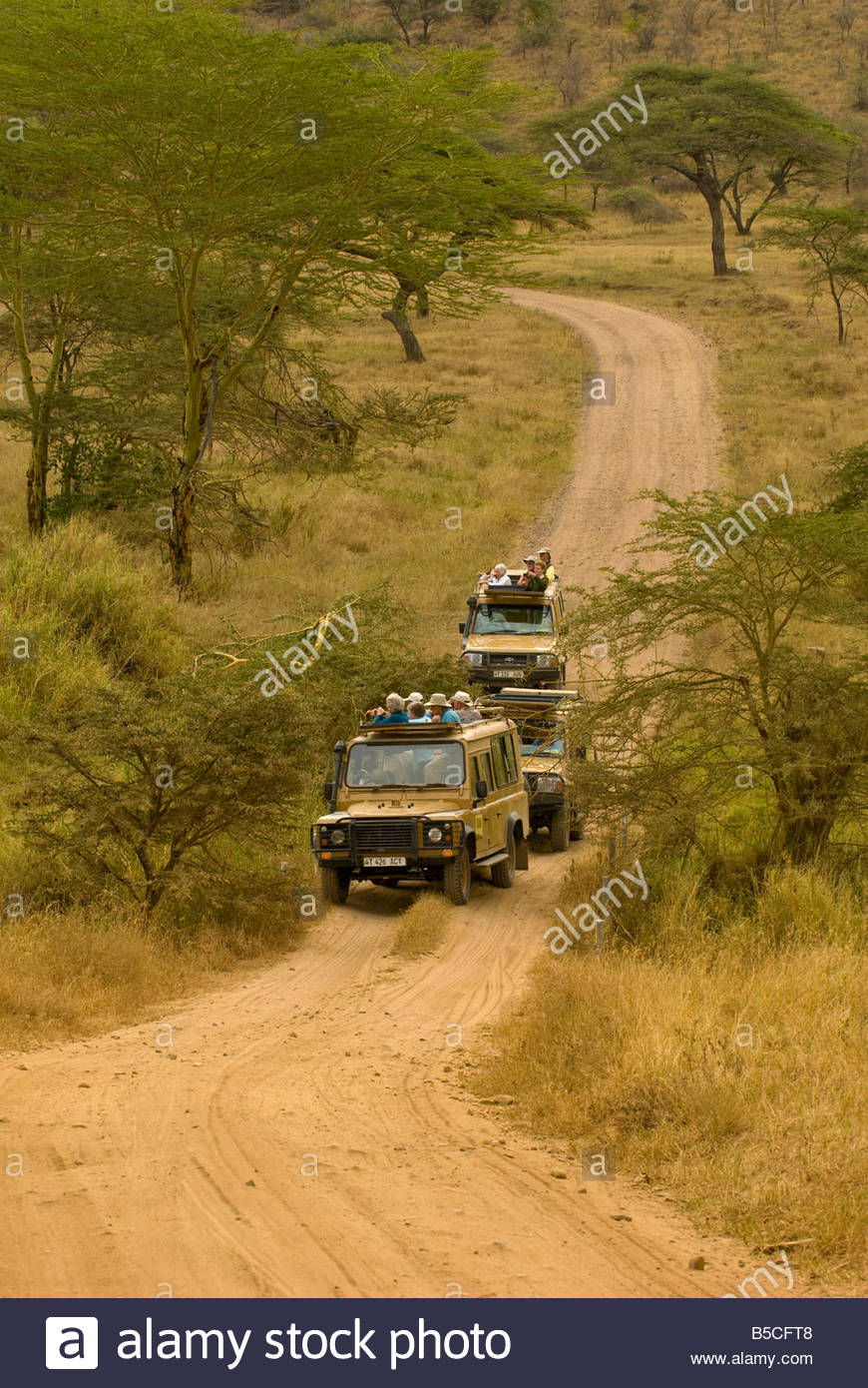 Safari vehicles Serengeti National Park Tanzania - Stock Image