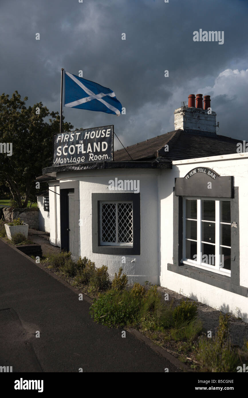 Gretna Green Marriage House with Scots Saltire flag flying 1st and last house in Scotland - Stock Image