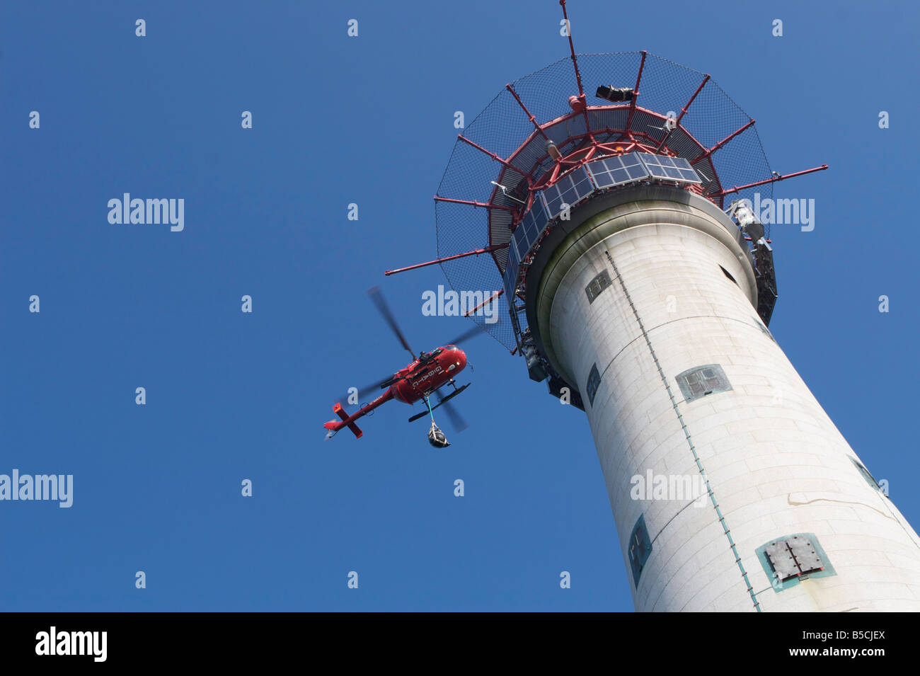 Helicopter dropping supplies at lighthouse - Stock Image