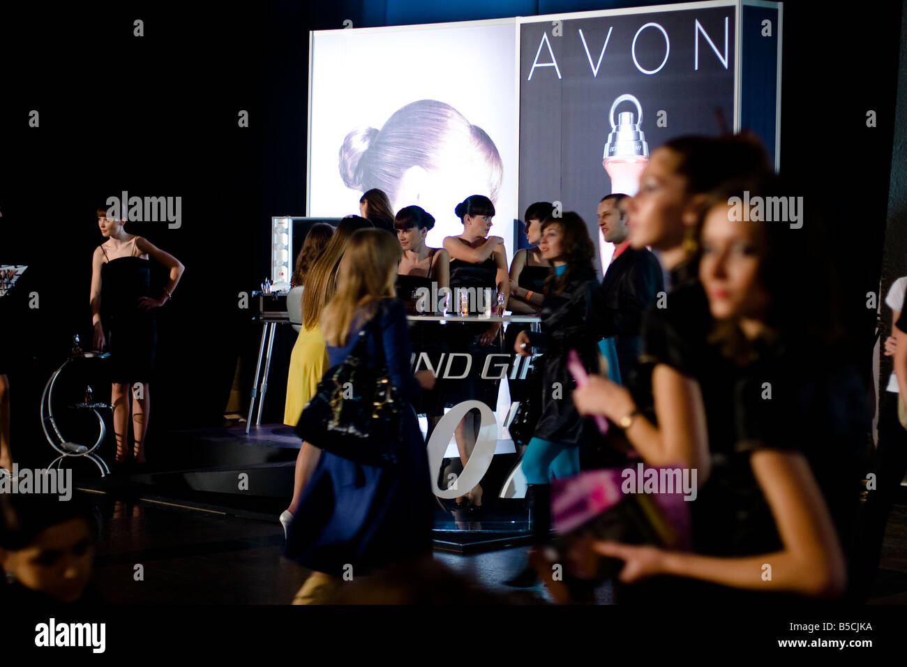 Hostesses at stand the Cosmetics company Avon in Frame the Ukrainian Fashion Week, in Kiev, Ukraine, Friday, Oct.17, - Stock Image