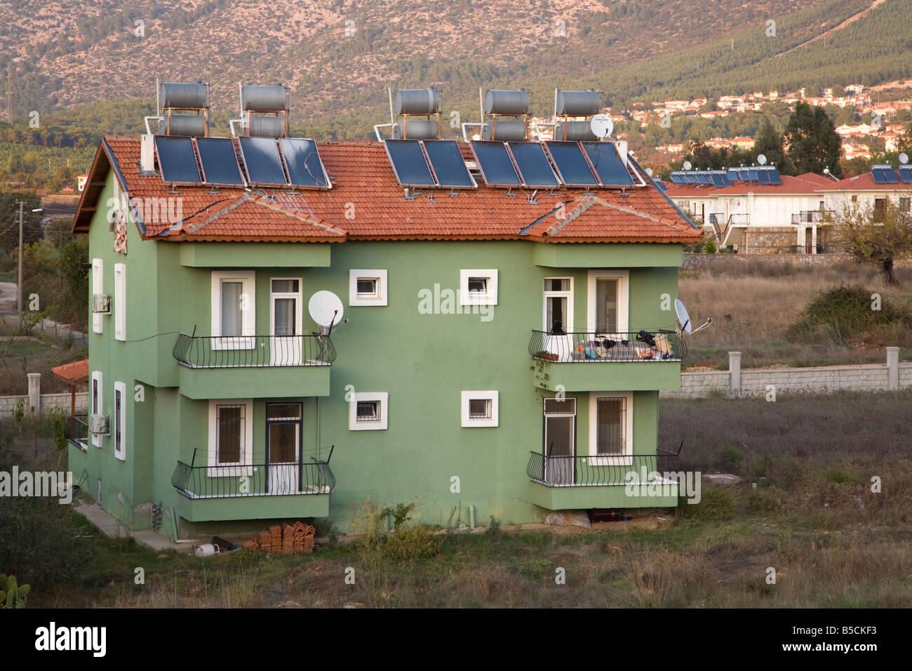 Solar panels on a apartment rooftops in Hisoranu, near Fethiye Turkey - Stock Image