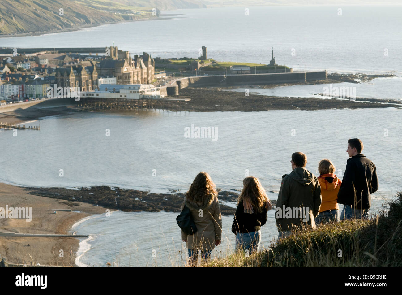 group of 5 University students on Constitution Hill overlooking the seaside resort town of Aberystwyth Wales UK - Stock Image