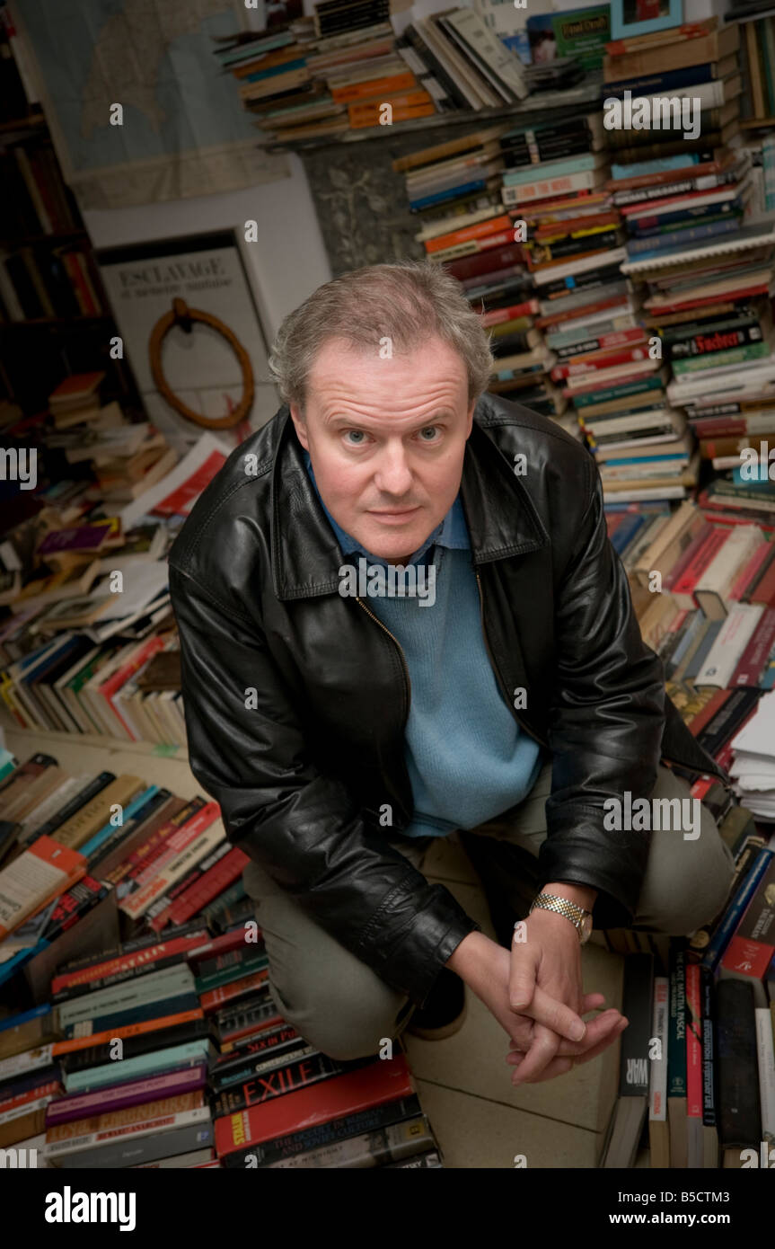 award winning welsh language novelist and playwright W O Wil William Owen Roberts, sitting amongst a pile of books - Stock Image