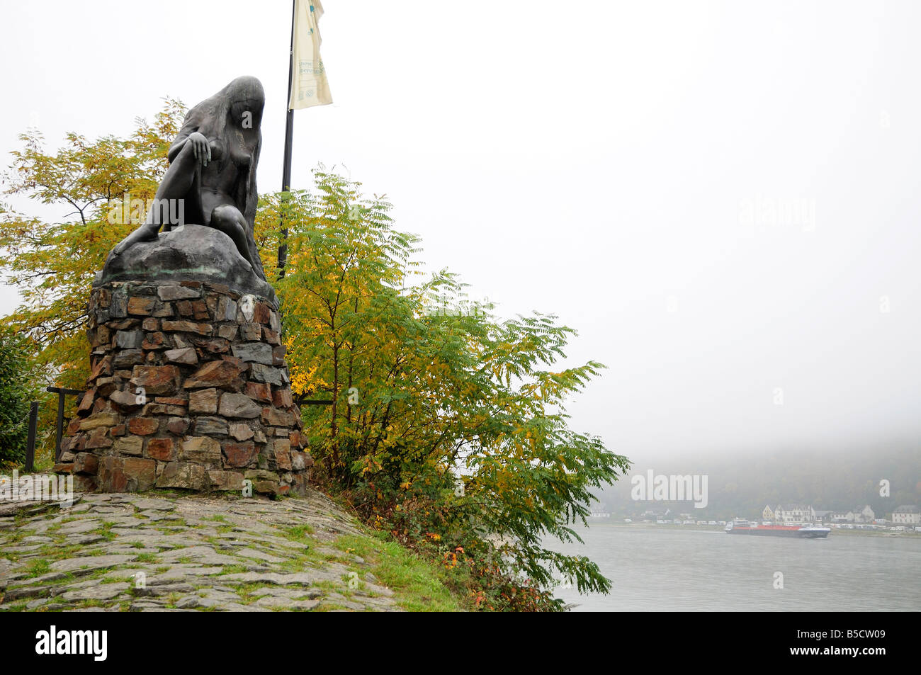 Statue of the Loreley in fog, Rhine river, Germany Stock Photo