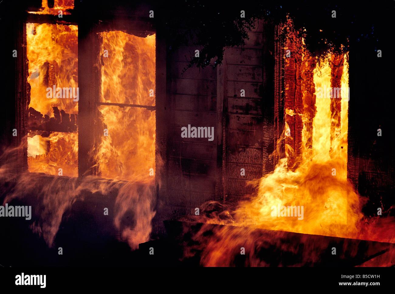 Inferno, engulfed window frames. - Stock Image