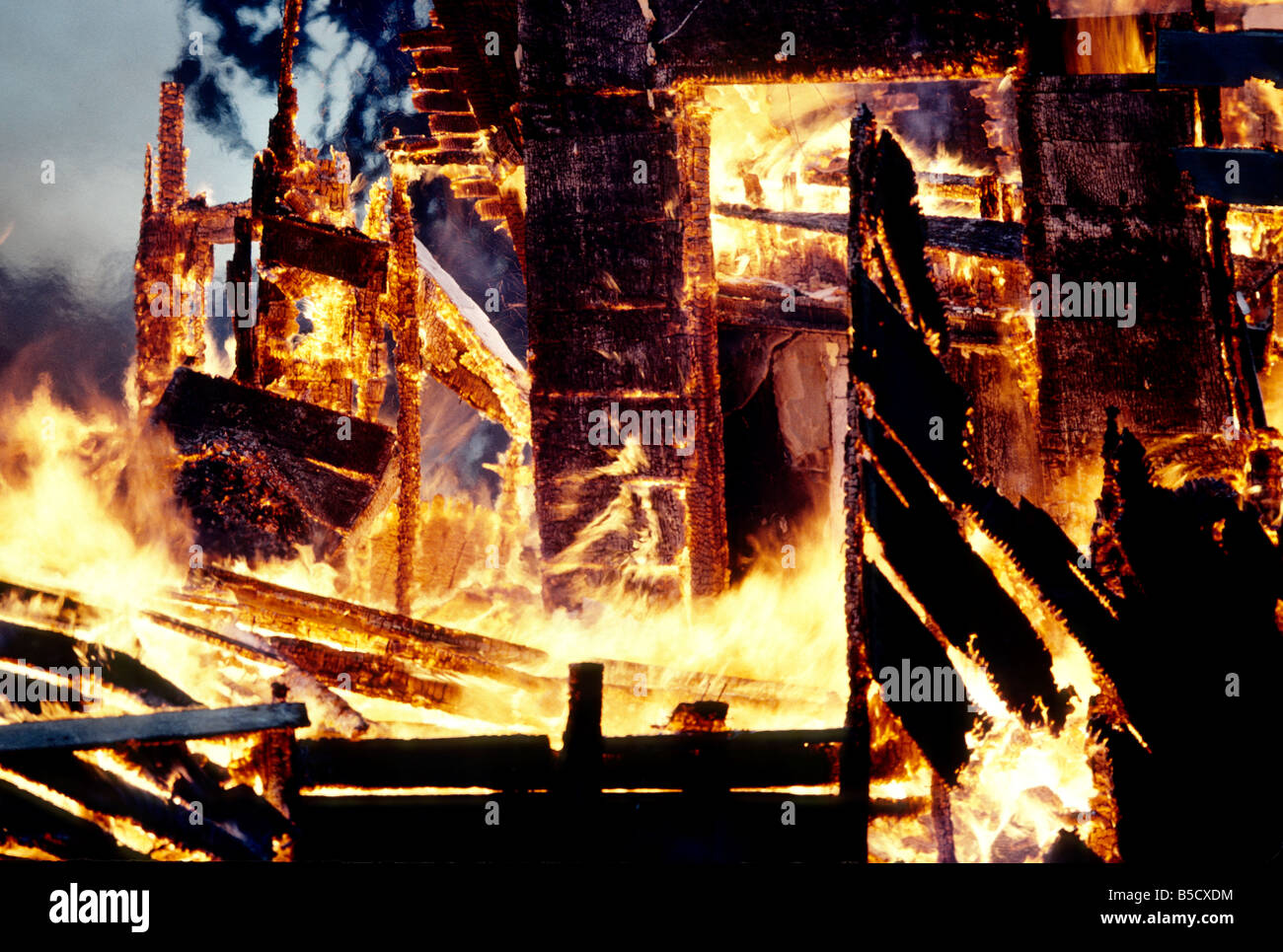 Inferno, flames consuming wood structure home. - Stock Image