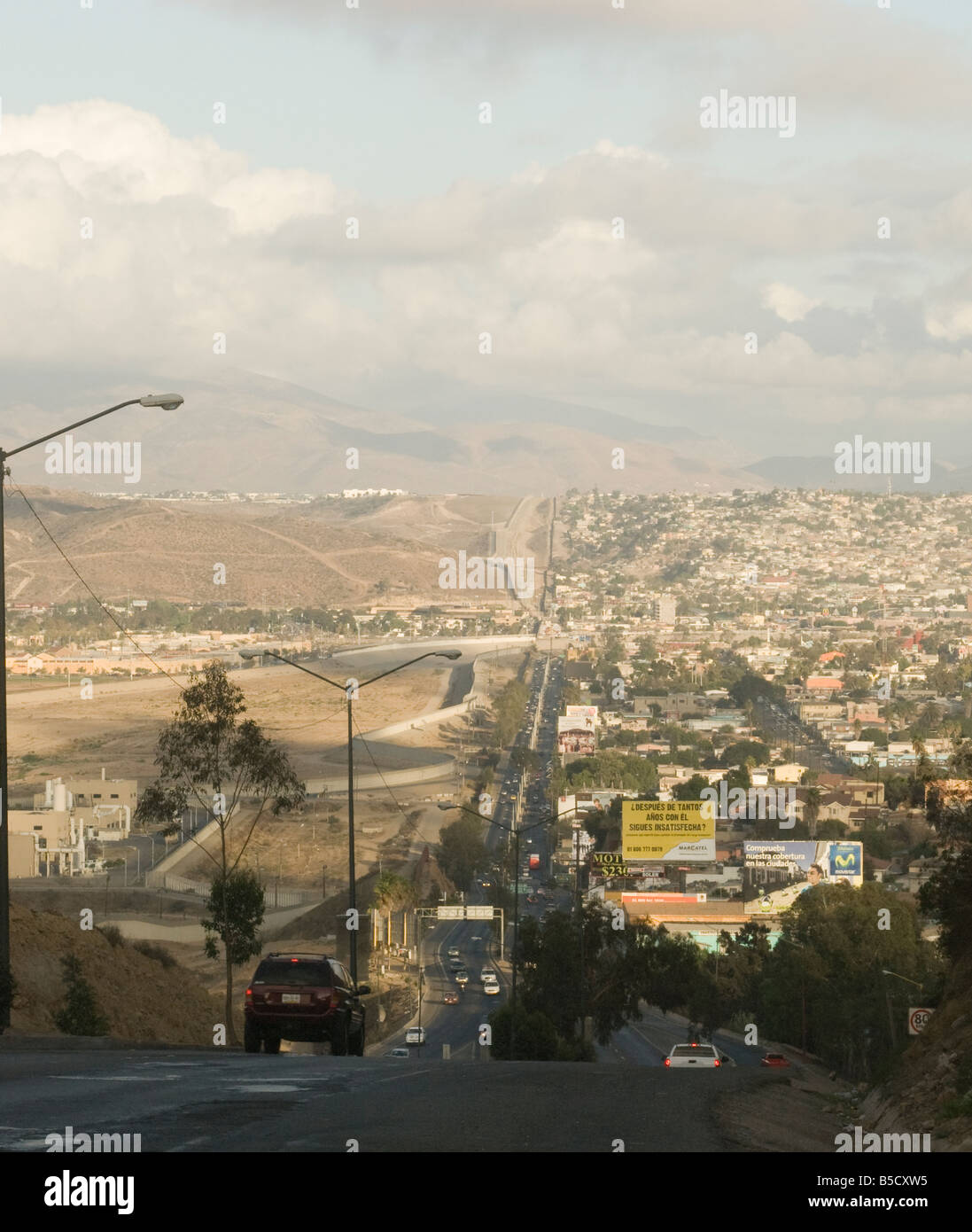View of the US Mexico border fence from a road in Tijuana Mexico - Stock Image