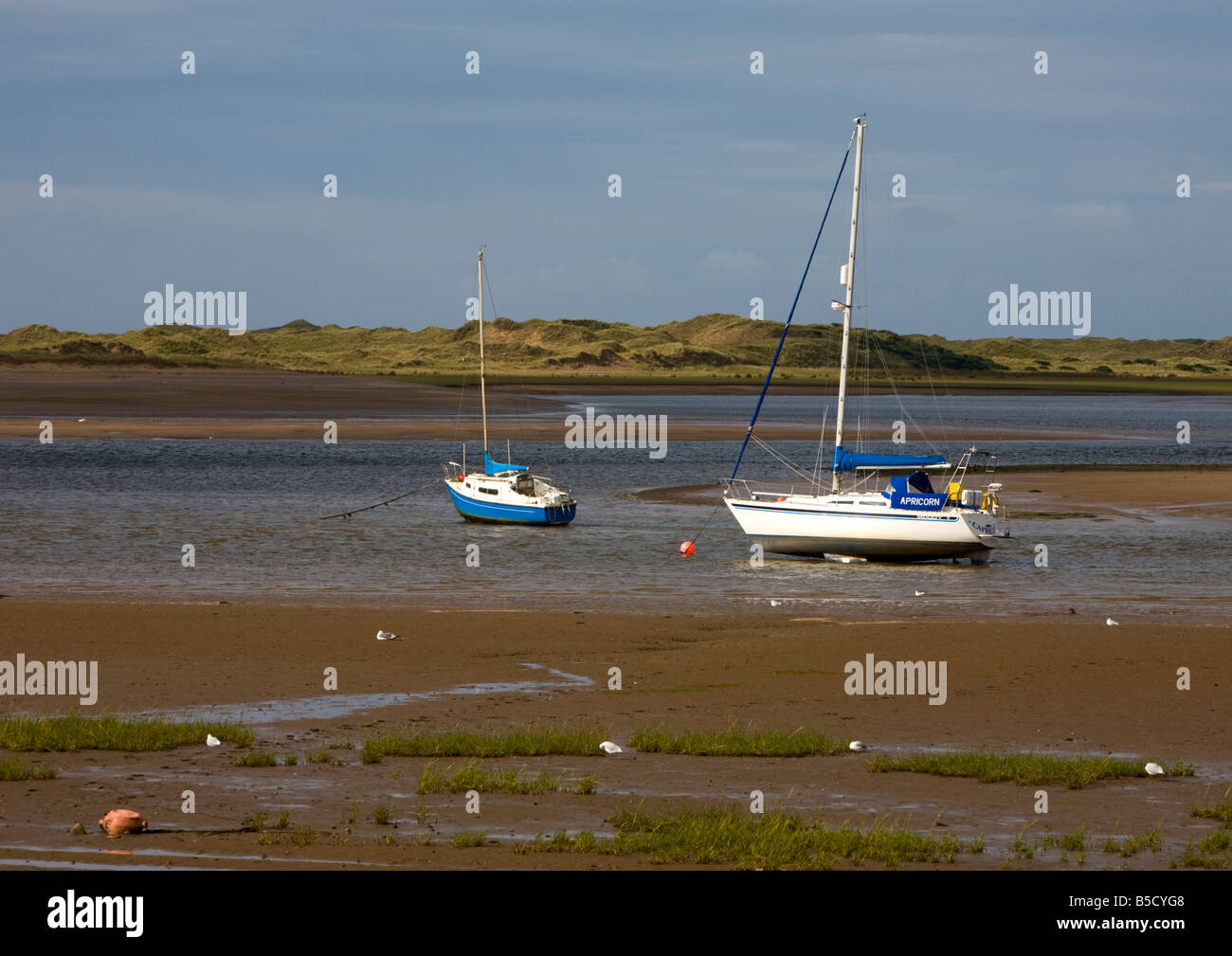 ravenglass cumbria harbour low tide beach beached bilge keel mooring boats yachts masts beacon leisure lake district - Stock Image