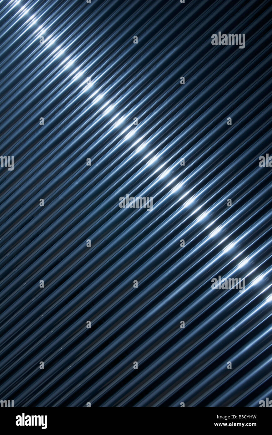 metallic tubes background - Stock Image
