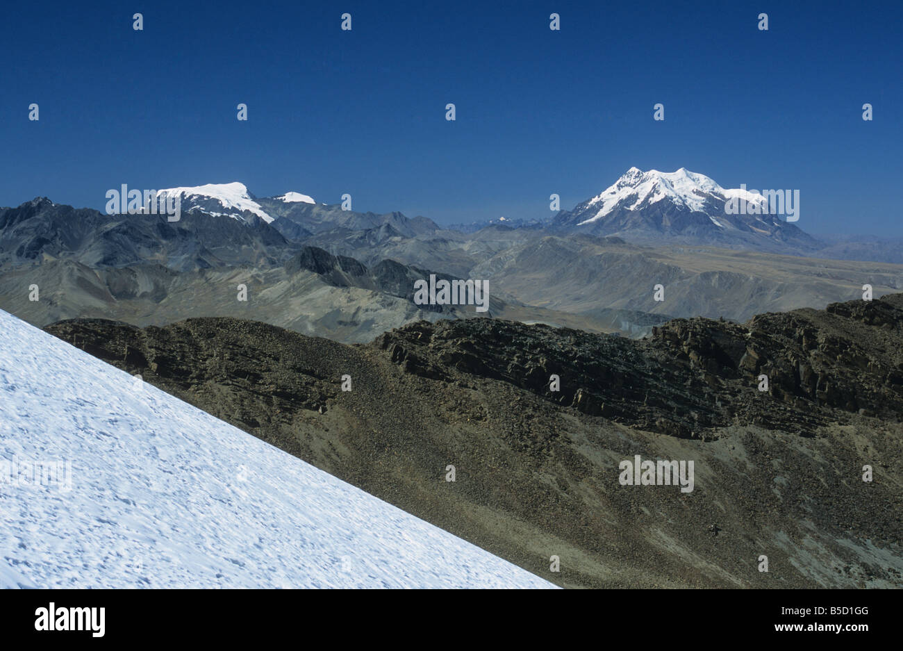 Mts Mururata (L) and Illimani (R) seen from Mt. Chacaltaya glacier in foreground, Cordillera Real, Bolivia - Stock Image