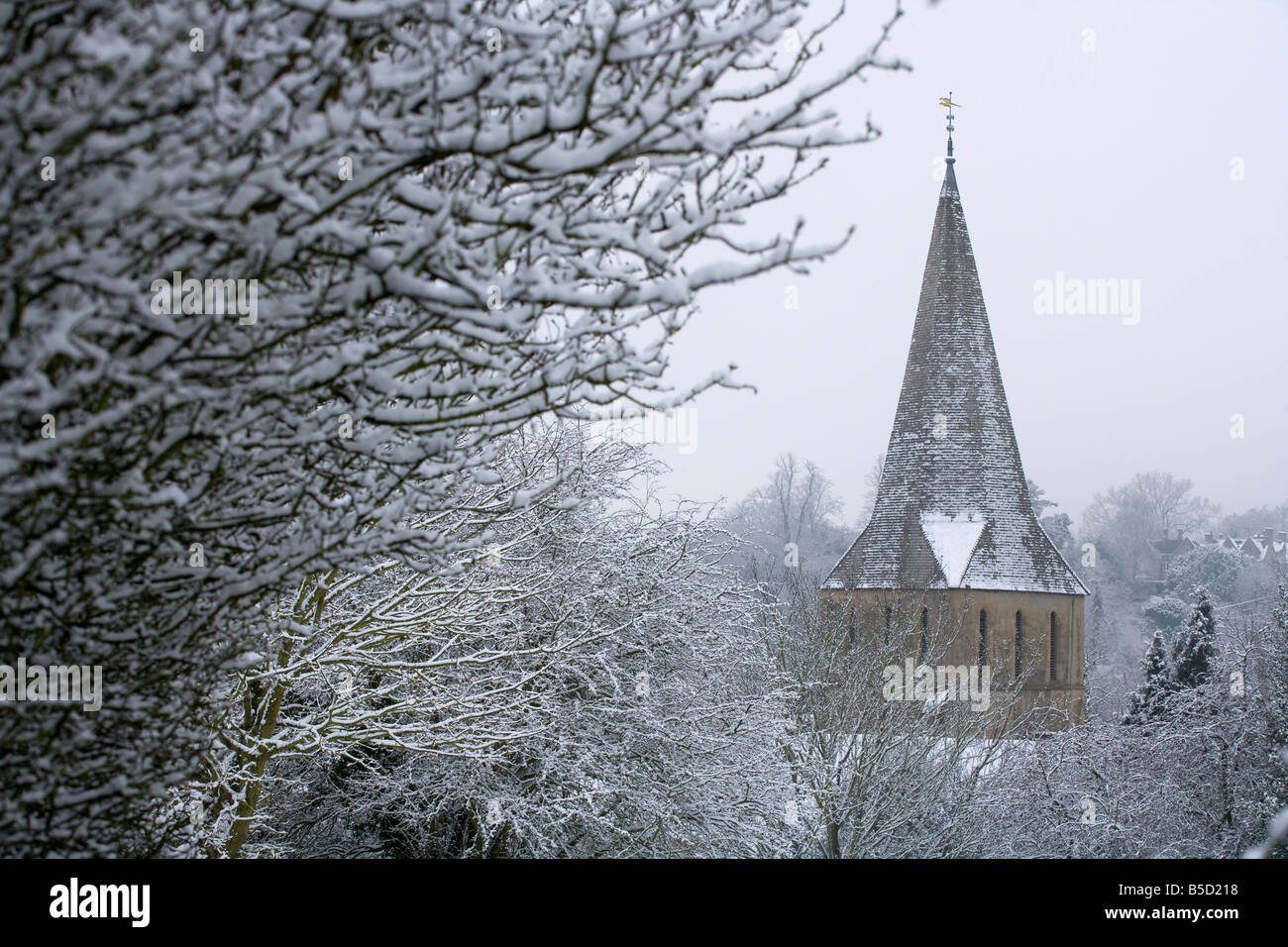 Shere church in snow, often used as a film location, Surrey, England, Europe - Stock Image