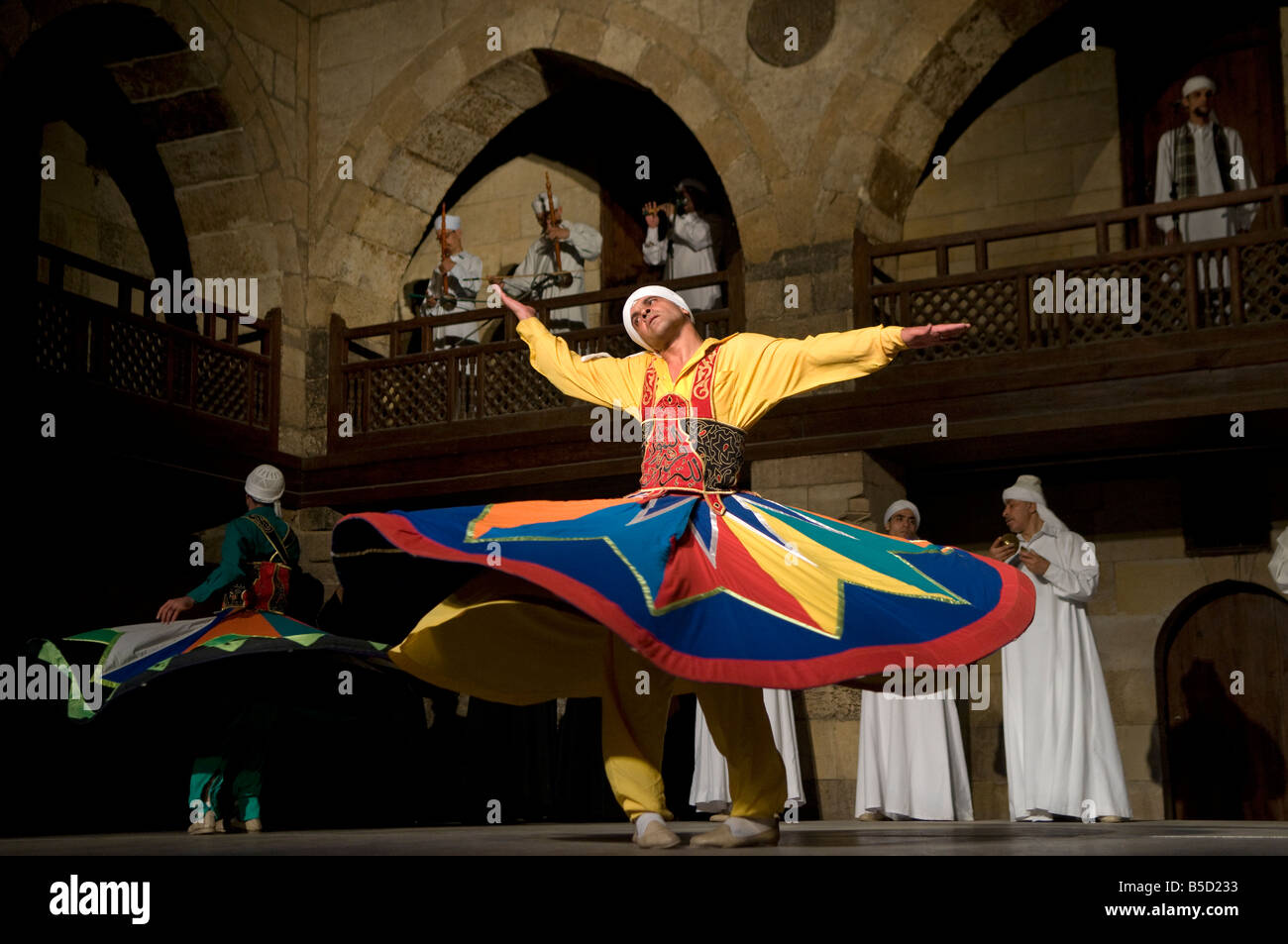Whirling Dervish or Darvish performance of al tannoura Egyptian heritage dance troupe at the Wekalet el Ghouri Arts - Stock Image